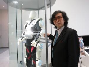 "<img src=""http://www.thenextrex.com/wp-content/uploads/2015/04/sankai-e1429000648124.jpg"" alt=""Cyberdyne's CEO - Mr. Yoshiuki Sankai>"