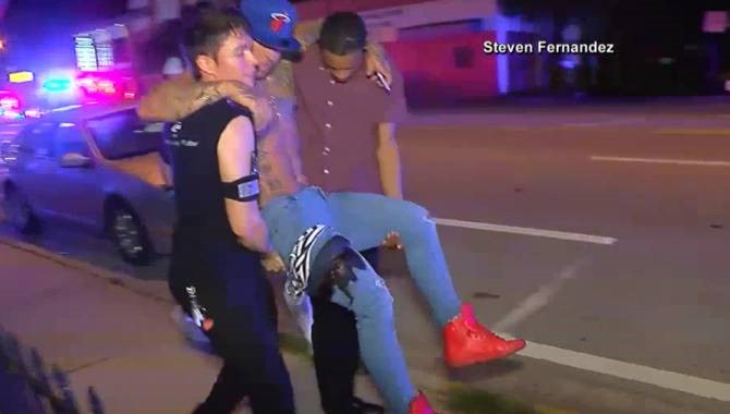 Orlando - Worst Mass Shooting in Night Club - Black Day in US History - people helping injurd